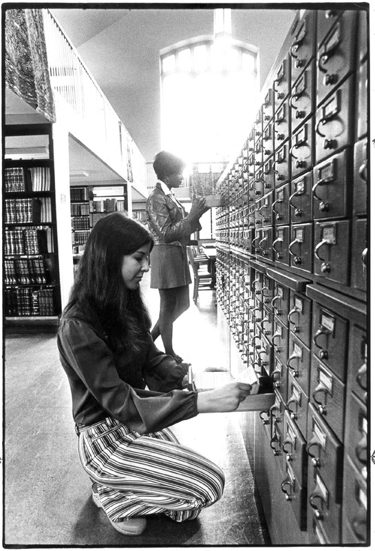 Students using card catalog