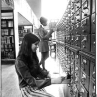 Students using card catalog